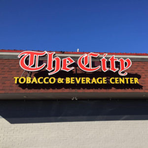 The City tobacco & beverage center sign, The City exterior sign